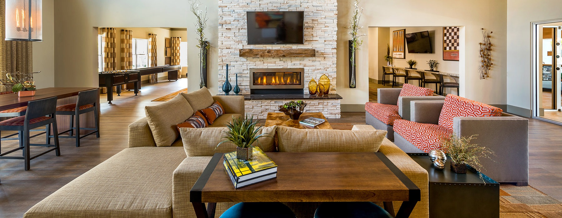 Spacious and well lit clubhouse with bar seating and ample chairs for entertaining.