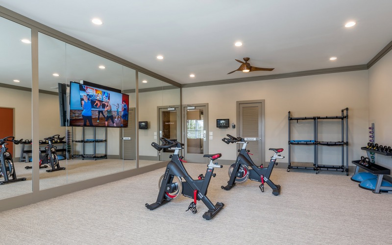 Large fitness center with cardio and weight lifting equipment.