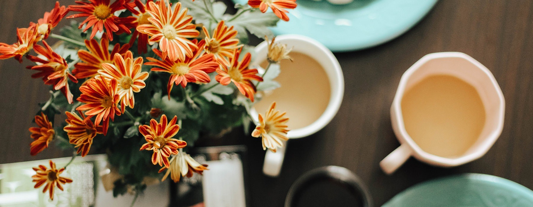 Flowers and coffee on a wood table